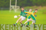 Colaiste na Sceilge Darragh O'Sullivan passes under pressure from St Brendan's Mike Coffey in Killorglin on Tuesday