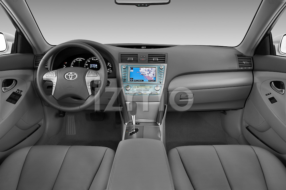 Straight dashboard view of a 2009 Toyota Camry Hybrid.