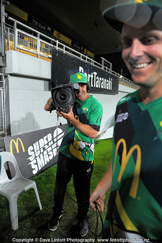 Marty Kain practises his camerawork as the rain stops play during the Super Smash T20 cricket match between the Central Stags and Northern Knights at Yarrow Stadium in New Plymouth, New Zealand on Saturday, 10 December 2016. Photo: Dave Lintott / lintottphoto.co.nz