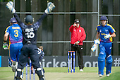 ICC World T20 Qualifier (Warm up match) - Scotland V Namibia at Grange CC, Edinburgh - Umpire Ian Ramage signals a wicket — credit @ICC/Donald MacLeod - 06.7.15 - 07702 319 738 -clanmacleod@btinternet.com - www.donald-macleod.com