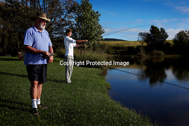 HOWICK, SOUTH AFRICA APRIL 6: Sixteen-year-old swimmer Michael Andrew fish with his grandfather on April 6, 2015 in Howick, Natal, South Africa. Michael has broken many records already and he is seen as the new Michael Phelps. He turned pro at 14 after signing his first endorsement deal. Peter, his father trains Michael and he grew up in the US. His parents emigrated from South Africa and he spent some time in the country in April 2015 to visit his grandparents. (Photo by: Per-Anders Pettersson)