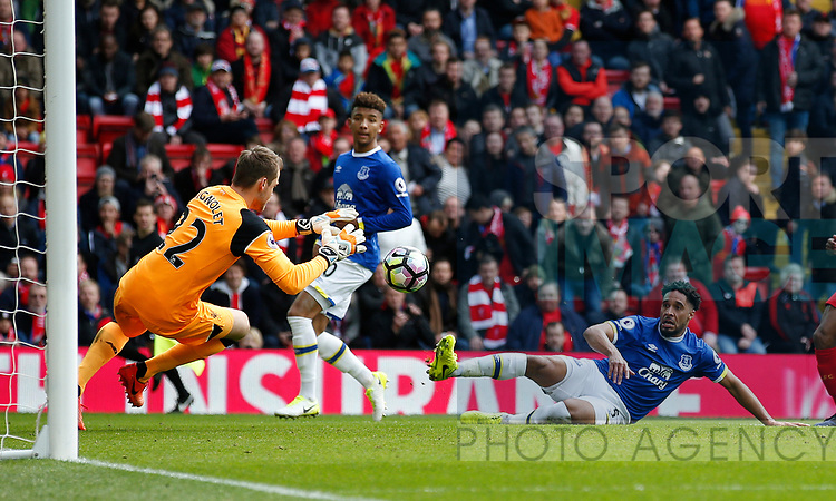 Ashley Williams of Everton clean through just kicks the ball towards Simon Mignolet of Liverpool during the English Premier League match at Anfield Stadium, Liverpool. Picture date: April 1st 2017. Pic credit should read: Simon Bellis/Sportimage