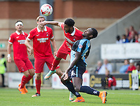 Frazer Shaw of Leyton Orient clears from Aaron Pierre of Wycombe Wanderers during the Sky Bet League 2 match between Leyton Orient and Wycombe Wanderers at the Matchroom Stadium, London, England on 19 September 2015. Photo by Andy Rowland.
