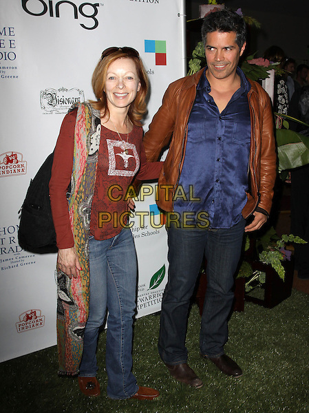 FRANCES FISHER & ESAI MORALES .40th Annivesary of Earth Day held At The JW Marriott LA Live, Los Angeles, California, USA, 22nd April 2010..full length brown top print pattern scarf jeans leather jacket tan blue shirt  .CAP/ADM/KB.©Kevan Brooks/AdMedia/Capital Pictures.