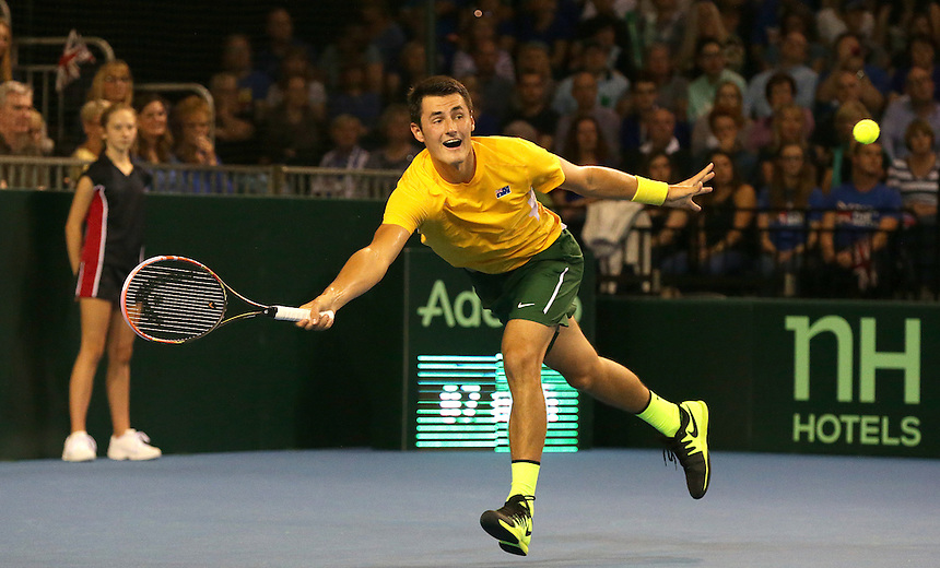Bernard Tomic in action during his match against Dan Evans<br /> <br /> Photographer Stephen White/CameraSport<br /> <br /> International Tennis - 2015 Davis Cup by BNP Paribas - World Group Semi-Final - Great Britain v Australia - Day 1 - Friday 18th September 2015 - The Emirates Arena - Glasgow<br /> <br /> &copy; CameraSport - 43 Linden Ave. Countesthorpe. Leicester. England. LE8 5PG - Tel: +44 (0) 116 277 4147 - admin@camerasport.com - www.camerasport.com.