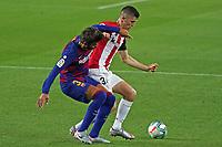 23rd June 2020, Camp Nou, Barcelona, Spain; La Liga Football league, FC Barcelona versus Athletico Bilbao;  Oihan Sancet of Bilbao holds off the challenge from Gerard Pique