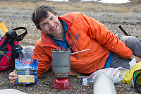 Mark simon cooks dehydrated food on a wilderness trip along the Ribdon River in the Brooks Range, Alaska