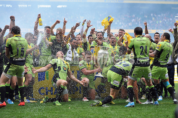 Northampton Saints players celebrate being crowned Aviva Premiership Champions. Aviva Premiership Final, between Saracens and Northampton Saints on May 31, 2014 at Twickenham Stadium in London, England. Photo by: Patrick Khachfe / JMP