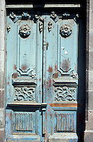 Weathered Spanish colonial door in old Quito, Ecuador. Old Quito was made a UNESCO World Heritage Site in 1978.