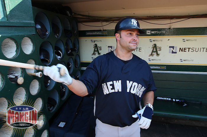 OAKLAND, CA - AUGUST 17:  Nick Swisher #33 of the New York Yankees gets ready to take batting practice before the game against the Oakland Athletics at the Oakland-Alameda County Coliseum on August 17, 2009 in Oakland, California. Photo by Brad Mangin
