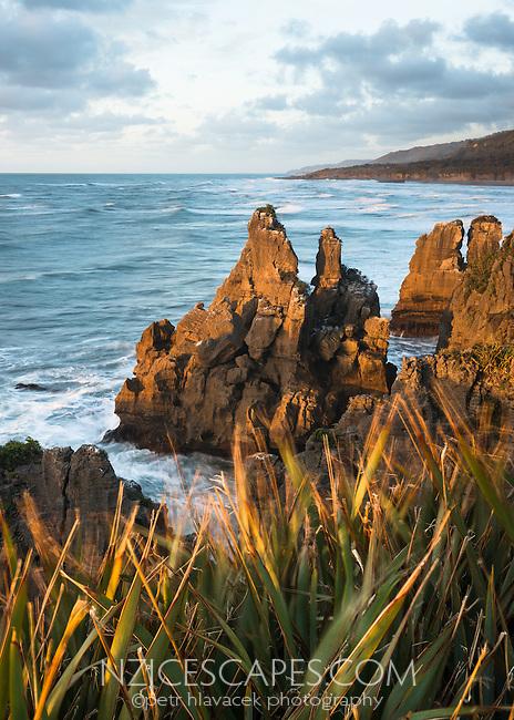 Sunset on rock formations at pancake rocks in Punakaiki, Buller Region, Paparoa National Park, West Coast, New Zealand, NZ