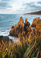 Sunset on rock formations at pancake rocks in Punakaiki, Buller Region, Paparoa National Park, West Coast, New Zealand, NZ