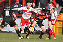 Barry Robson of Sheffield United is challenged by Gavin Mahon of Stevenage. Stevenage v Sheffield United - npower League 1 -  Lamex Stadium, Stevenage - 16th March, 2013. © Kevin Coleman 2013.. . . .