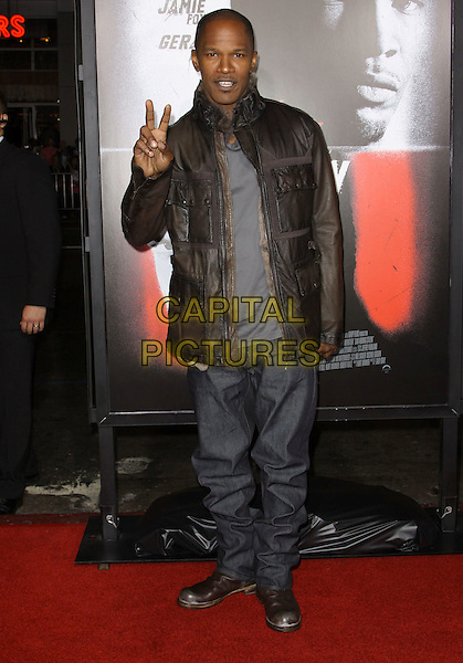 JAMIE FOXX.The Overature Film L.A. Premiere of Law Abiding Citizen held at The Grauman's Chinese Theater in Hollywood, California, USA. .October 6th, 2009 .full length jaime grey gray jeans denim leather jacket top brown hand v peace sign .CAP/ADM/KB.©Kevan Brooks/AdMedia/Capital Pictures.