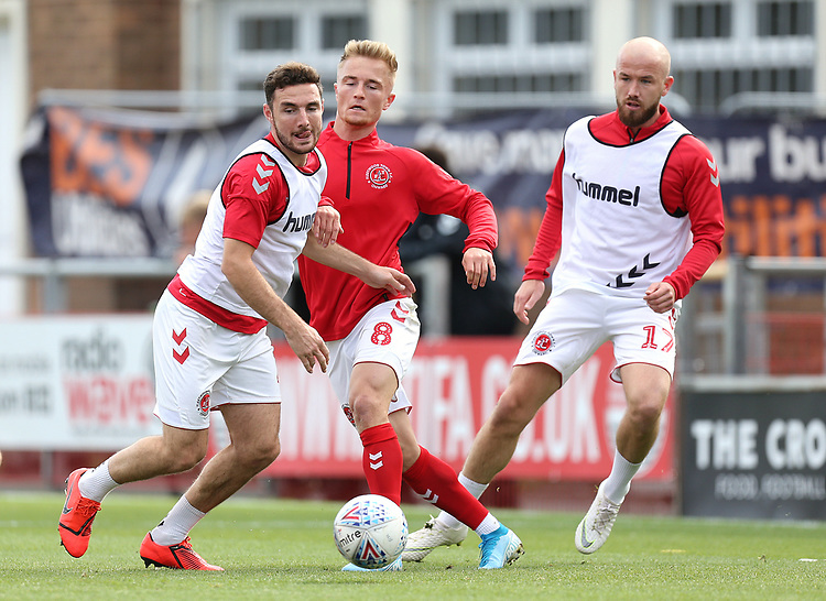 Fleetwood Town's (from left) Lewis Coyle, Kyle Dempsey and Paddy Madden during the pre-match warm-up <br /> <br /> Photographer Rich Linley/CameraSport<br /> <br /> The EFL Sky Bet League One - Fleetwood Town v Oxford United - Saturday 7th September 2019 - Highbury Stadium - Fleetwood<br /> <br /> World Copyright © 2019 CameraSport. All rights reserved. 43 Linden Ave. Countesthorpe. Leicester. England. LE8 5PG - Tel: +44 (0) 116 277 4147 - admin@camerasport.com - www.camerasport.com
