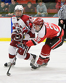 Alex Killorn (Harvard - 19), Jake Klancher (St. Lawrence - 28) - The St. Lawrence University Saints defeated the Harvard University Crimson 3-2 on Friday, November 20, 2009, at the Bright Hockey Center in Cambridge, Massachusetts.
