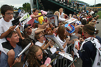 USWNT's Abby Wambach signs autographs for fans following the game in which she scored her 100th career goal in the second half. The U.S. Women's National Team defeated Canada 1-0 in a friendly match at Marina Auto Stadium in Rochester, NY on July 19, 2009.
