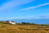 County Galway, Ireland: White cottagbe overlooking the  North Atlantic, near Tullycross, along the Connemara Loop