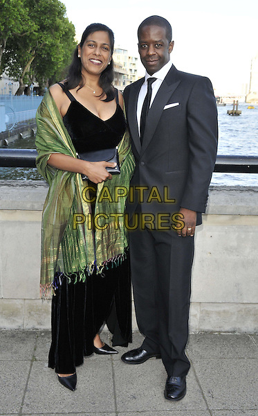 LONDON, ENGLAND - JUNE 18: Lolita Chakrabarti &amp; Adrian Lester attend the National Film &amp; TV School's ( NFTS ) Gala, Old Billingsgate, Old Billingsgate Walk, Lower Thames St., on Wednesday June 18, 2014 in London, England, UK.<br /> CAP/CAN<br /> &copy;Can Nguyen/Capital Pictures