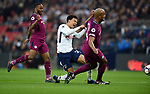 Dele Alli of Tottenham Hotspur is challenged by Vincent Kompany of Manchester City during the premier league match at the Wembley Stadium, London. Picture date 14th April 2018. Picture credit should read: Robin Parker/Sportimage