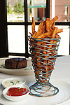 The sea salt french fries with ketchup and malt vinegar tartar sauce at Vic & Anthony's  Saturday Aug. 21,2010. Also pictured is a fillet mignon.(Dave Rossman/For the Chronicle)