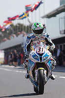 Vittorio Iannuzzo (ITA) riding the BMW S1000 RR (31) of the Grillini DENTALMATIC SBK Team leaving the pits for a practise session on day one of round one of the 2013 FIM World Superbike Championship at Phillip Island, Australia.