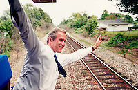 05 Aug 2000, Michigan, USA --- Republican Presidential candidate George W. Bush leans out the back of a train through Michigan after the Republican convention. --- Image by © Brooks Kraft/Sygma/Corbis
