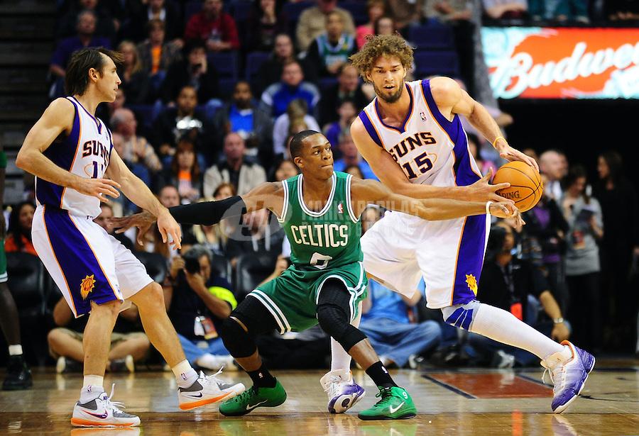 Jan. 28, 2011; Phoenix, AZ, USA; Boston Celtics guard Rajon Rondo (9) is flanked by Phoenix Suns guard (13) Steve Nash and center (15) Robin Lopez at the US Airways Center. Mandatory Credit: Mark J. Rebilas-