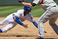 Round Rock shortstop Jurickson Profar (10) dives back to first base during a pickoff attempt against the Nashville Sounds in the Pacific Coast League baseball game on May 5, 2013 at the Dell Diamond in Round Rock, Texas. Round Rock defeated Nashville 5-1. (Andrew Woolley/Four Seam Images).