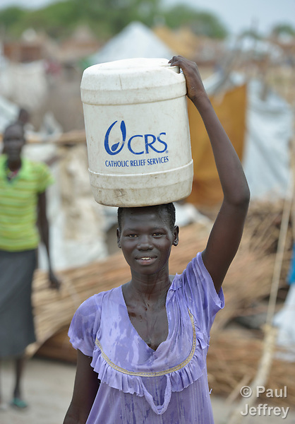 Nidia Panom carries water in Poktap, a town in South Sudan's Jonglei State where conflict, climate, and corruption have caused severe food insecurity. Panom and many others in this town have just returned from years of displacement. Catholic Relief Services, the humanitarian arm of the U.S. Catholic Bishops Conference, works in Poktap providing a variety of services, including jerry cans for women and girls to carry clean water.