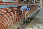 A girl washing herself outside the cow barn at the Wisconsin State Fair in West Allis, Wis. on August 3, 2008.