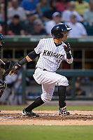 Ronald Bueno (16) of the Charlotte Knights follows through on his swing against the Indianapolis Indians at BB&T BallPark on June 16, 2017 in Charlotte, North Carolina.  The Knights defeated the Indians 12-4.  (Brian Westerholt/Four Seam Images)