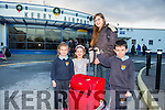 People home for Christmas arriving at Kerry Airport on Monday were Anna, Brid and Tadhg McCarthy picking up Lucy Hezinger