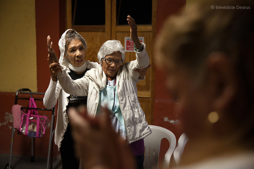 Residents of Casa Xochiquetzal attends a weekly prayer service at the shelter in Mexico City, Mexico on June 8, 2016. Casa Xochiquetzal is a shelter for elderly sex workers in Mexico City. It gives the women refuge, food, health services, a space to learn about their human rights and courses to help them rediscover their self-confidence and deal with traumatic aspects of their lives. Casa Xochiquetzal provides a space to age with dignity for a group of vulnerable women who are often invisible to society at large. It is the only such shelter existing in Latin America. Photo by Bénédicte Desrus