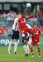 July 21, 2010  Bolton Wanderer Gary Cahill No. 5 and Toronto FC O'Brian White No. 17 in action during the Carlsberg Cup match between the Bolton Wanderers FC and Toronto FC at BMO Field in Toronto..Th Bolton Wanderrs FC won 4-3 on penalty kicks.