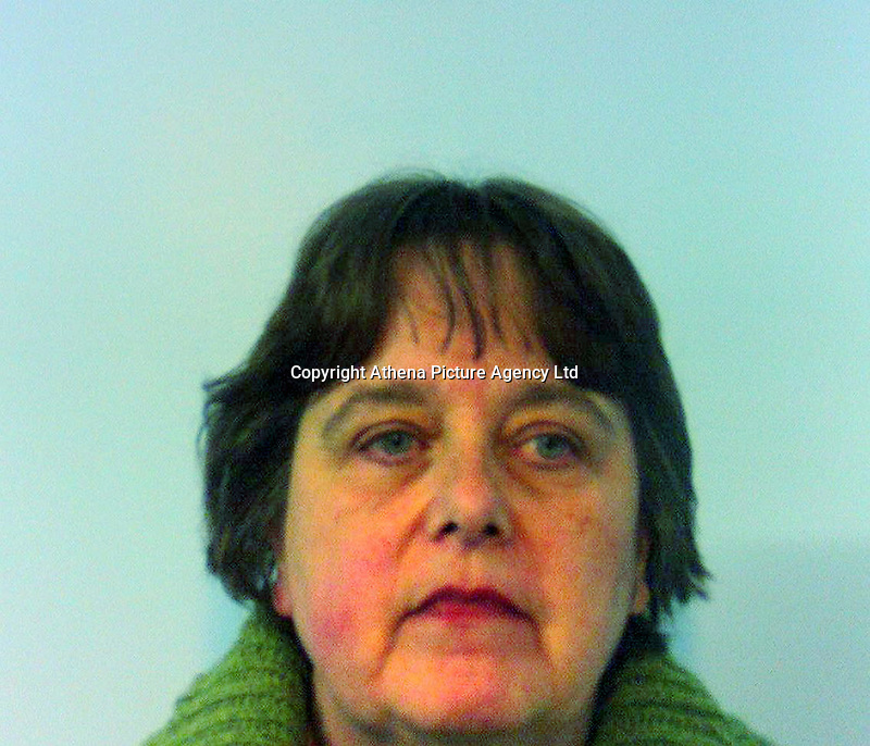 Pictured: Undated police custody picture of Susan Jones.<br /> Re: A company secretary who stole almost &pound;1m from a supermarket's accounts after her family's Carmarthenshire farm ran into difficulties has been jailed.<br /> Susan Jones, 57, transferred the cash from CK Supermarkets' accounts where she had worked for 20 years to help out the farm in Llandeilo.<br /> She was jailed for 45 months after pleading guilty to fraud at Swansea Crown Court on Friday.<br /> Judge Peter Heywood described the theft as &quot;staggering&quot;.<br /> The court heard how the mother-of-four, who started working for the supermarket in 1994, handled all the company's accounts as her boss was &quot;computer illiterate&quot;.<br /> She started transferring the cash into her bank account in 2009 after her family farm ran into financial problems.<br /> Over a four-year-period Jones stole &pound;955,368, using it to pay off her mortgage and for agricultural supplies.<br /> The theft was eventually spotted following an audit by an accountant.<br /> Frank Phillips, prosecuting, said the police only became involved when she failed to pay back the cash.<br /> Terence Woods, defending, said Jones's farm had been in her family for several generations and she was &quot;desperate not to lose it&quot;.<br /> Share this story About sharing