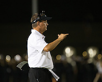 Cedar Park Timberwolves wide receivers coach Pecos McDaniel calls in a signal during a high school football game between Cedar Park High School and Vandegrift High School at Gupton Stadium in Cedar Park on Friday, September 2, 2016.
