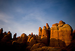 Sunset lights the rock formations of the Fiery Furnace area in Arches National Park, Moab, Utah.