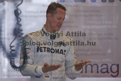 Mercedes Formula One driver Michael Schumacher of Germany prepares for the free pracitce session of the Hungarian F1 Grand Prix in Mogyorod (about 20km north-east from Budapest), Hungary. Friday, 27. July 2012. ATTILA VOLGYI