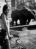 Wroclaw, Poland, April 4, 2009:<br /> Tina Wygralak, visitor at the .Wroclaw Zoo, standing by the elephants.  (Photo by Piotr Malecki / Napo Images)...Tina Wygralak, dziewczyna odwiedzajaca Zoo, obok wybiegu sloni..Wroclaw, Kwiecien 2009.Fot: Piotr Malecki / Napo Images