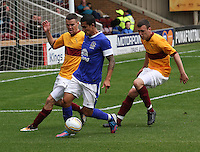 Tim Cahill closed down by Adam Cummins and Simon Ramsden in the Motherwell v Everton friendly match at Fir Park, Motherwell on 21.7.12 for Steven Hammell's Testimonial.