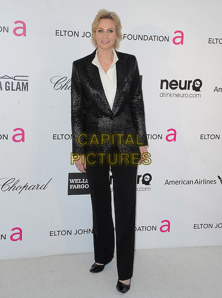 Jane Lynch.The 21st Annual Elton John AIDS Foundation Academy Awards Viewing Party held at The City of West Hollywood Park in West Hollywood, California, USA..February 24th, 2013.oscars full length black blazer trousers shirt suit  white         .CAP/DVS.©DVS/Capital Pictures.