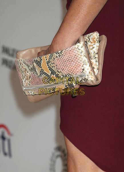 Marcia Gay Harden's bag<br /> PaleyFest Previews: Fall TV with ABC - &quot;Trophy Wife&quot; and &quot;Back in the Game&quot; held at The Paley Center for Media, Beverly Hills, California, USA.<br /> September 10th, 2013<br /> hand detail gold pink strap snakeskin print maroon  <br /> CAP/ADM/RE<br /> &copy;Russ Elliot/AdMedia/Capital Pictures