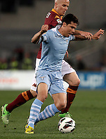 Calcio, Serie A: Roma vs Lazio. Roma, Stadio Olimpico, 8 aprile 2013..Lazio midfielder Hernanes, of Brazil, foreground, is challenged by AS Roma midfielder Michael Bradley, of the United States, during the Italian serie A football match between A.S. Roma  and Lazio at Rome's Olympic stadium, 8 april 2013..UPDATE IMAGES PRESS/Isabella Bonotto