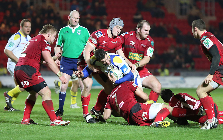 Clermont Auvergne's Napolioni Nalaga is tackled by Scarlets' Josh Turnbull ..Rugby Union - Heineken Cup Pool 5 - Scarlets v Clermont Auvergne - Saturday 19th January 2013 - Parc y Scarlets - Llanelli....