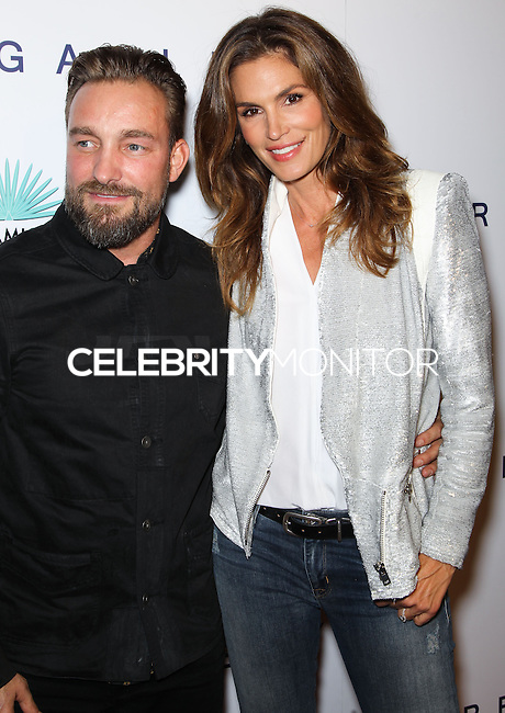 WEST HOLLYWOOD, CA, USA - OCTOBER 23: Brian Bowen Smith, Cindy Crawford arrive at Brian Bowen Smith's First Solo Show 'Wildlife' held at the De Re Gallery on October 23, 2014 in West Hollywood, California, United States. (Photo by Celebrity Monitor)