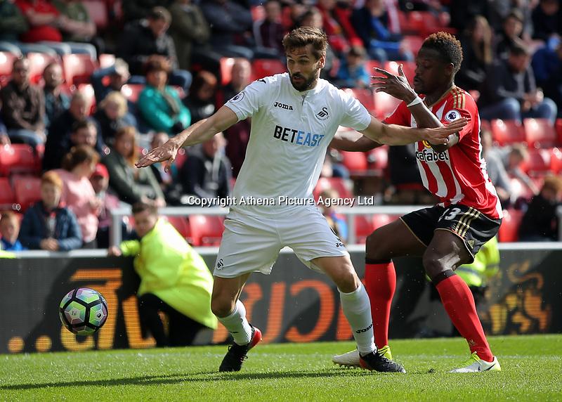 (L-R) Fernando Llorente of Swansea City pushes away Lamine Kone of Sunderland during the Premier League match between Sunderland and Swansea City at the Stadium of Light, Sunderland, England, UK. Saturday 13 May 2017