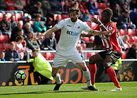 (L-R) Fernando Llorente of Swansea City pushes away Lamine Kone of Sunderland during the Premier League match between Sunderland and Swansea City at the Stadium of Light, Sunderland, England, UK. Saturday 13 May 2017