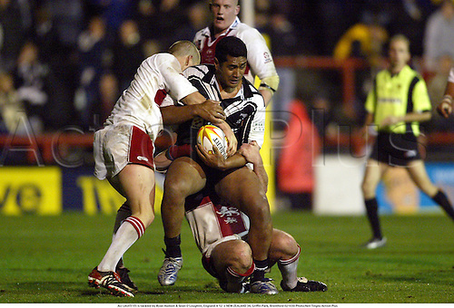 ALI LAUITI'ITI is tackled by Ryan Hudson & Sean O'Loughlin, England A 12  v NEW ZEALAND 34, Griffin Park, Brentford 021030 Photo:Neil Tingle/Action Plus...2002.rugby league.Kiwis