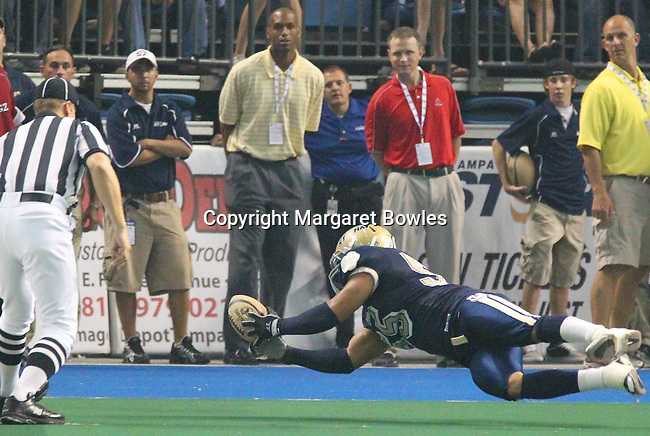 05 June 2010: Tampa Bay Storm linebacker Eric Ortiz goes airborne to attempt an interception against Oklahoma City.  The Tampa Bay Storm defeated the Oklahoma City Yard Dawgz 50-48 at the St. Pete Forum in Tampa, Florida
